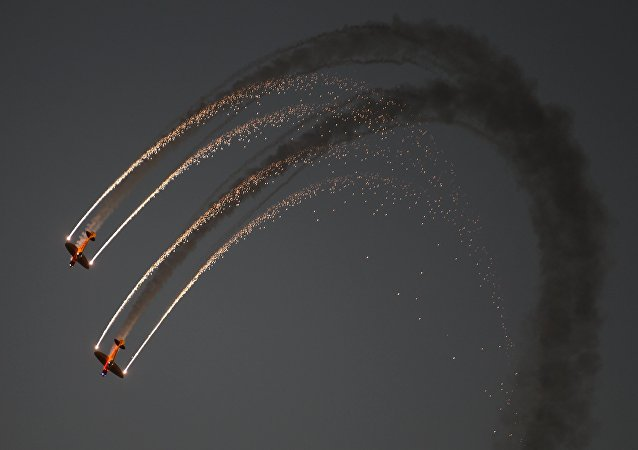 DHL's Twisters & Extra 300 perform during the second day of the Bahrain Air Show 2016 at Sakhir, south of Bahrain January 22, 2016.