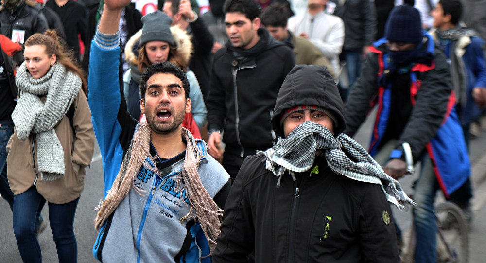 Migrants march on January 23, 2016 in the French port city of Calais, northern France, during a demonstration to support migrants who live in the 'jungle', an encampment made up of migrants who are mainly trying to reach Britain.