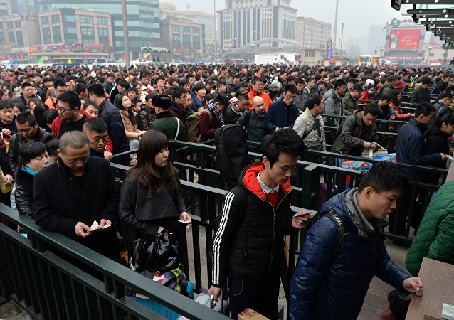 Chinese travellers queuing at the railway station in Beijing