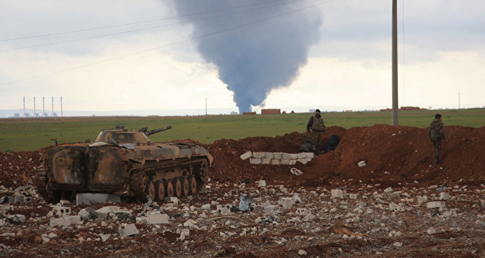 Syrian pro-government forces hold a position as smoke billows following an air strike on Daesh militants' position in the Hatabat al-Bab area, near town of Al-Bab in Aleppo's eastern countryside, on January 24, 2016