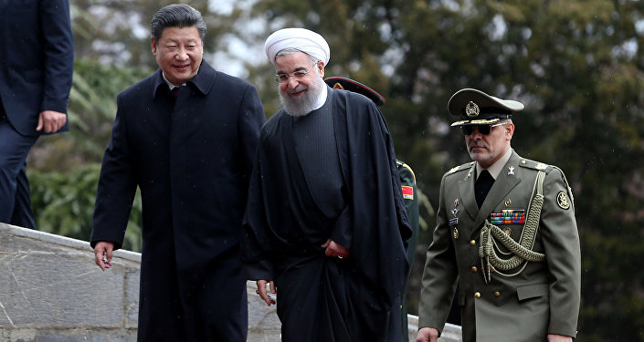 Chinese President Xi Jinping, left, is welcomed by Iranian President Hassan Rouhani during his official arrival ceremony at the Saadabad Palace in Tehran, Iran, Saturday, Jan. 23, 2016.