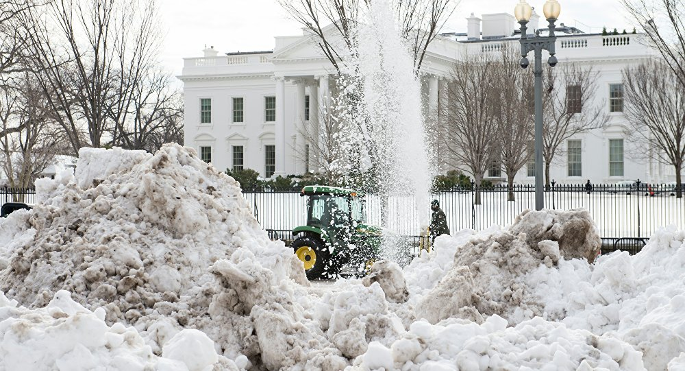 A snowblower clears Pennsylvania Avenue in front of the White House in Washington, DC, on January 26, 2016, three days after a massive snowstorm