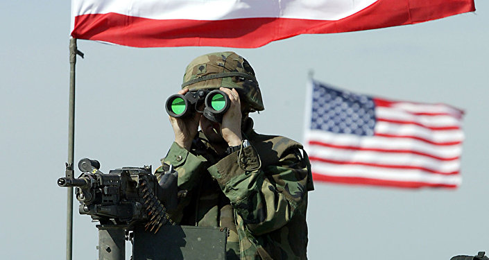 A US soldier peers through binoculars