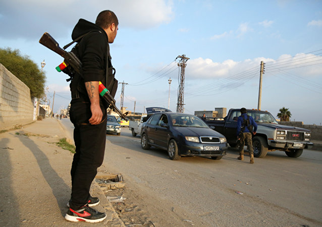 Members of the Kurdish internal security forces (known as the Asayish) check vehicles on December 16, 2015 in the northeastern Syrian city of Qamishli as tensions rose between regime forces and Kurdish fighter in the city