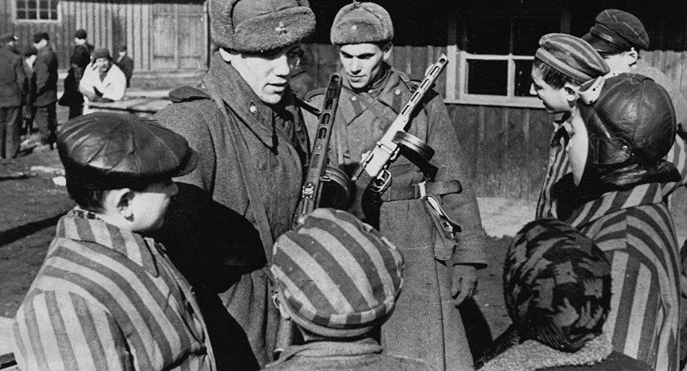 Soviet soldiers liberating Auschwitz