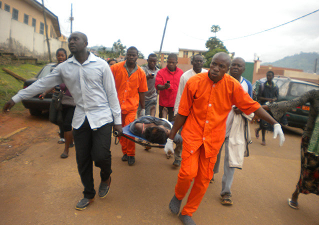 Cameroon Medics evacuate the body (File)