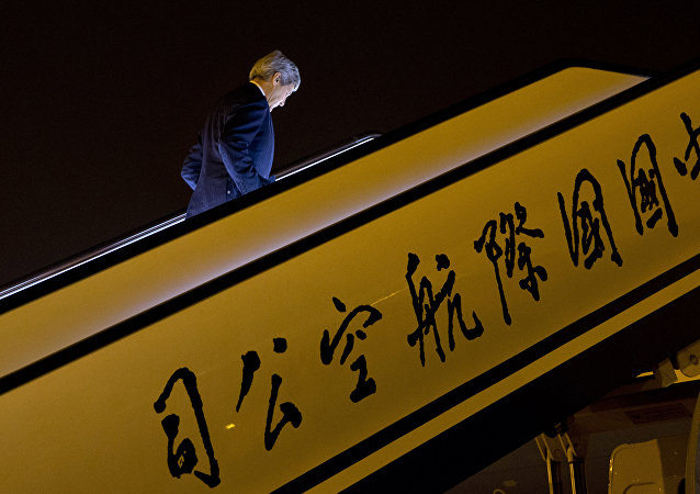 U.S. Secretary of State John Kerry boards his plane as he leaves Beijing to return to Washington, Wednesday, Jan. 27, 2016