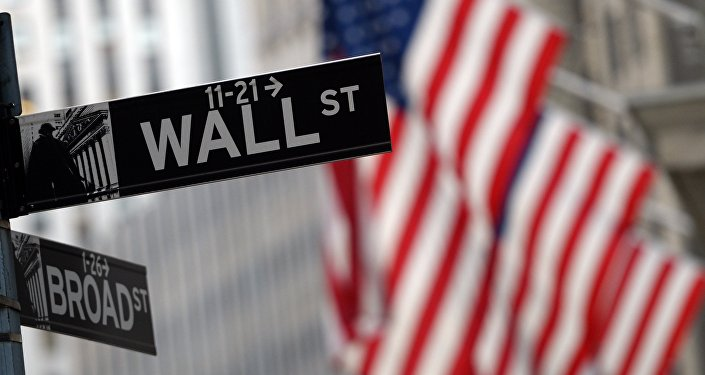This file photo taken on January 07, 2016 shows a street sign at the corner of Wall and Broad Street across from the New York Stock Exchange
