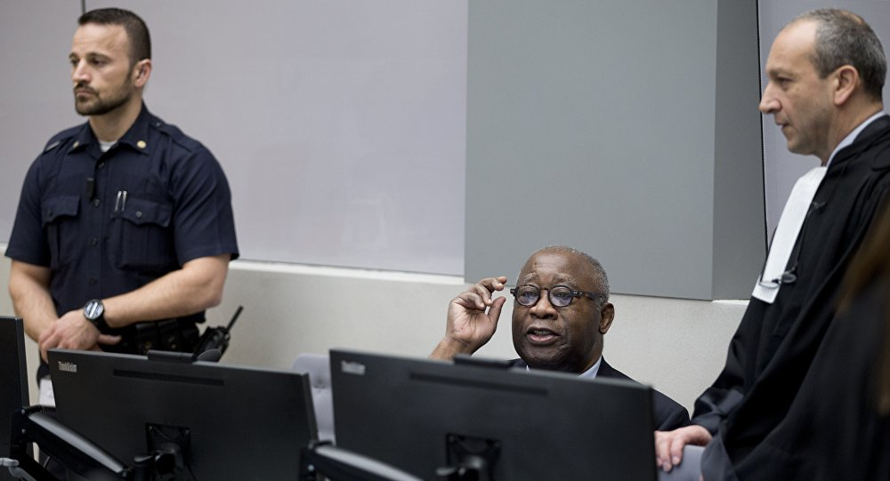Former Ivory Coast president Laurent Gbagbo (C) and his lawyer Emmanuel Altit (R) wait for the start of his trial at the International Criminal Court in The Hague on January 28, 2016