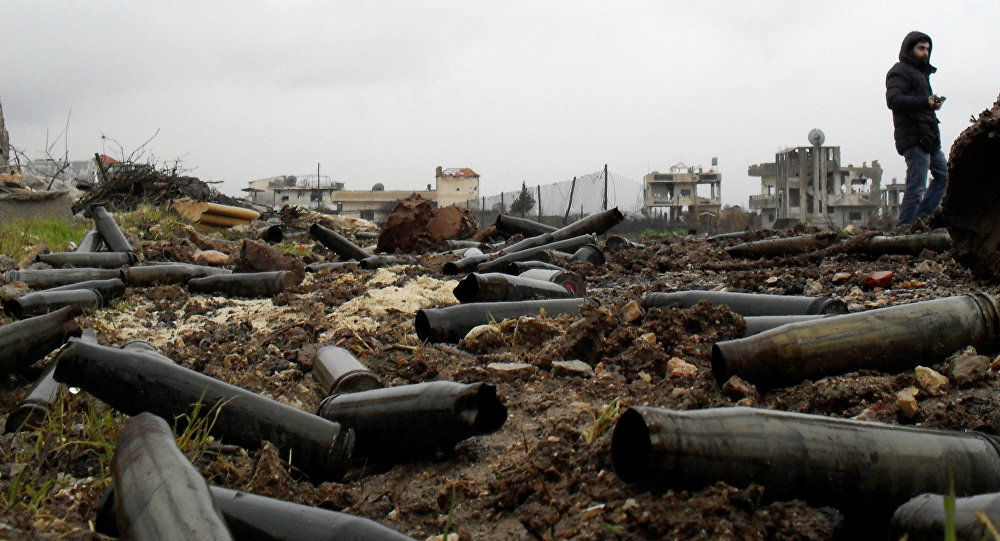 A picture taken on January 26, 2016 shows artillery casings on the ground after Syrian pro-government forces retook the town of Sheikh Miskeen in southern Daraa province from rebel forces