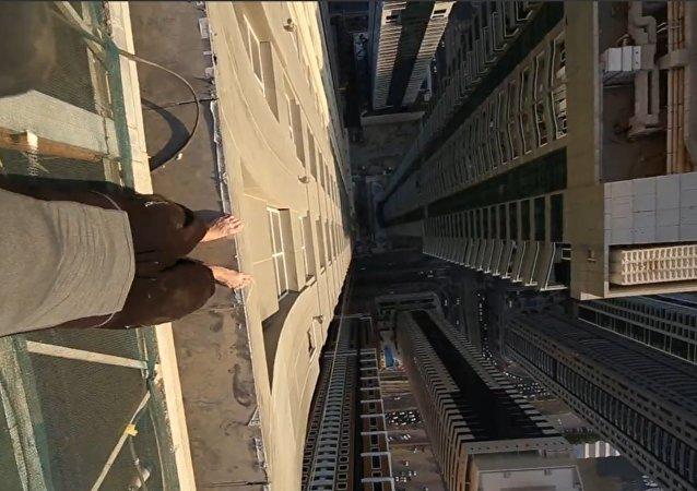 Man Walks on Edge of Dubai Highrise.