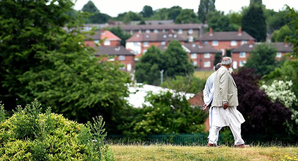 People walk in a park in Savile Town, Dewsbury