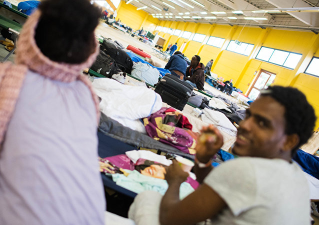 Refugees are seen in their temporary housing in a former hardware store in Hamburg, northern Germany