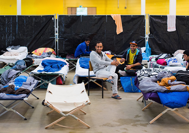 Refugees are seen in their temporary housing in a former hardware store in Hamburg, northern Germany.