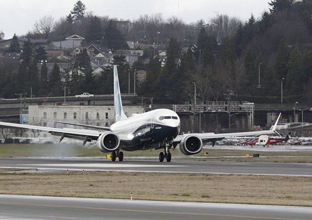 A Boeing 737 MAX returns from a flight test at Boeing Field in Seattle, Washington