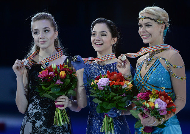 Medalists of the women's free skating program at the European Figure Skating Championships in Bratislava, Slovakia, during the awards ceremony, from left: Elena Radionova (Russia) - silver medal; Evgenia Medvedeva (Russia) - gold medal; Anna Pogorilaya (Russia) - bronze medal