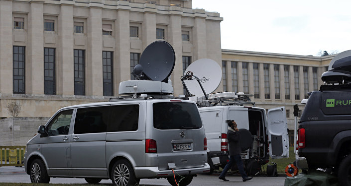 Television vans are pictured ahead of the start of Syrian talks in front of the United Nations European headquarters in Geneva.