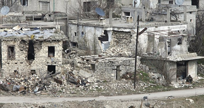 A general view shows damaged buildings.