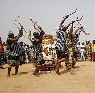 People watch as traditional drummers perform at the annual voodoo festival in Ouidah in Benin, January 10, 2016