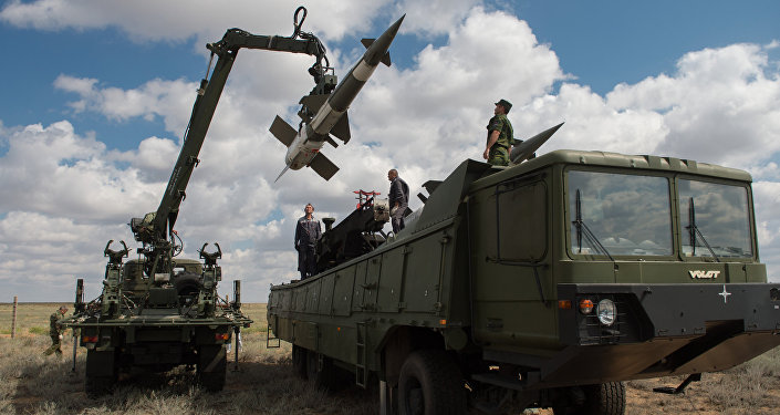 Servicemen load a Pechora-2M air defense complex of the Tajikistan armed forces during the 2013 Combat Commonwealth, a military drill for the CIS joint air defense system, at the Ashuluk training ground