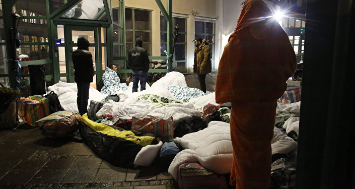 Refugees sleep outside the entrance of the Swedish Migration Agency's arrival center for asylum seekers at Jagersro in Malmo, Sweden (Photo used for illustration purpose)