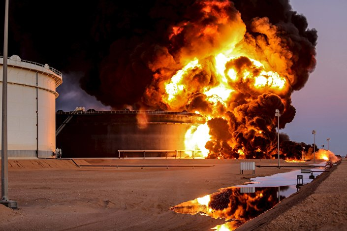 Fire rises from an oil tank in the port of Es Sider, in Ras Lanuf, Libya, in this file picture taken January 4, 2016.