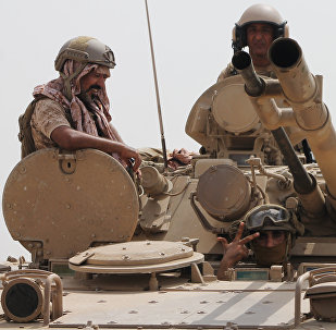 Soldiers stand on a tank of the Saudi-led coalition deployed on the outskirts of the southern Yemeni port city of Aden on August 3, 2015, during a military operation against Shiite Huthi rebels and their allies.