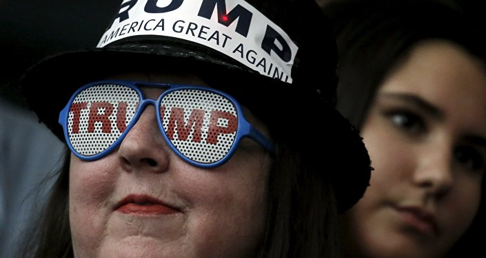 A supporter of Republican presidential candidate Donald Trump wears glasses with the word Trump on it as she listens to Mr Trump's remarks at a campaign rally in Milford, New Hampshire, February 2, 2016