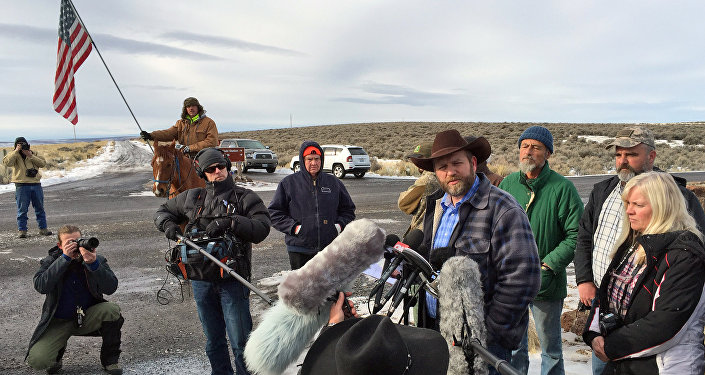 Ammon Bundy speaks to reporters at the Malheur National Wildlife Refuge in Burns, Ore., on Thursday, Jan. 14, 2016