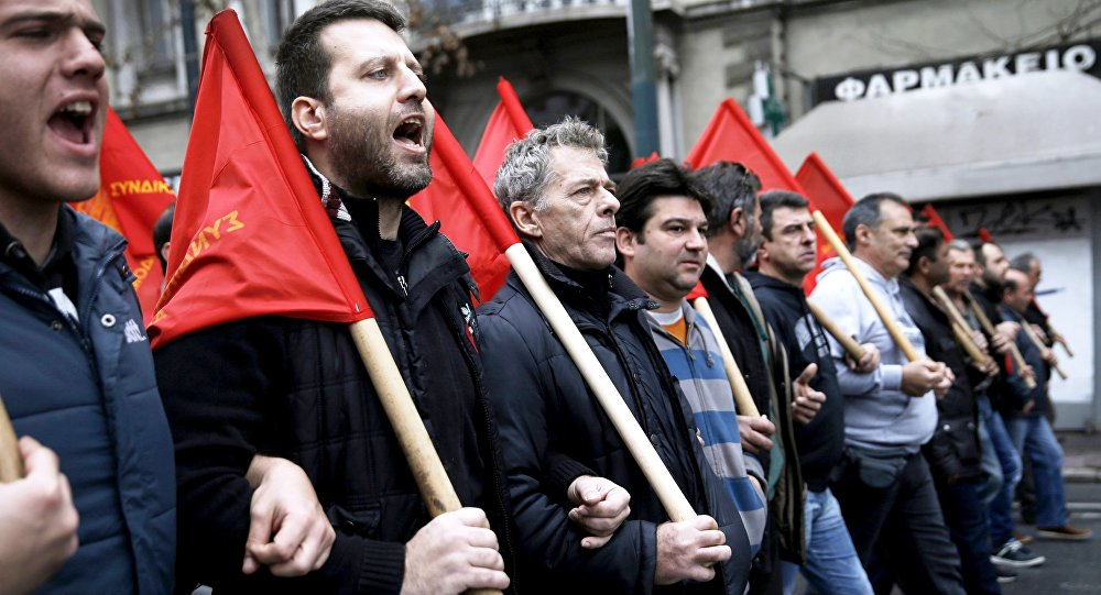 Protesters from the Communist-affiliated trade union PAME march during a 24-hour general strike against planned pension reforms in central Athens, Greece, February 4, 2016.