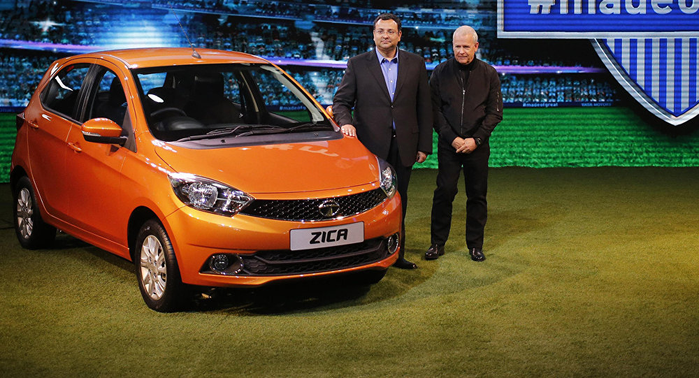 Chairman of Tata Group, Cyrus Mistry and Tata Motors' Head of Advanced and Product Engineering, Tim Leverton (R), pose with a Zica car during its launch at the Indian Auto Expo in Greater Noida, on the outskirts of New Delhi, India, February 3, 2016