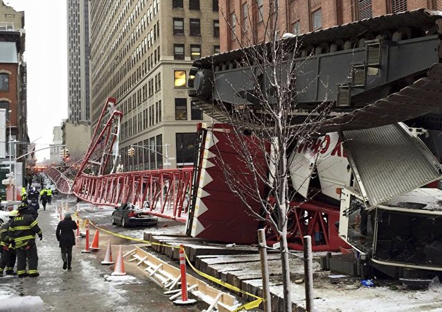 Emergency crews survey a massive construction crane collapse on a street in downtown Manhattan in New York, in a picture released by the New York City Fire Department on February 5, 2016.