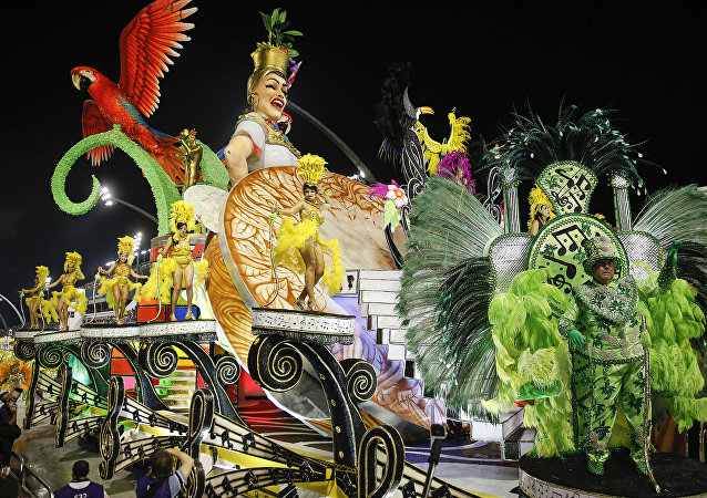 Dancers from the Unidos do Peruche samba school perform on a float during a carnival parade in Sao Paulo, Brazil, Saturday, Feb. 6, 2016