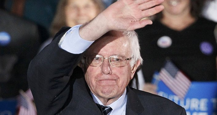 Bernie Sanders waves after winning at his 2016 New Hampshire presidential primary night rally in Concord, New Hampshire February 9, 2016