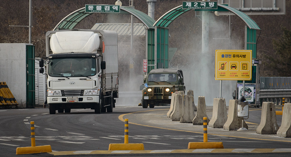 A vehicle leaving the Kaesong joint industrial zone passes through disinfectant spray before a checkpoint at the CIQ immigration centre near the Demilitarized Zone (DMZ) separating North an South Korea, in Paju on February 11, 2016