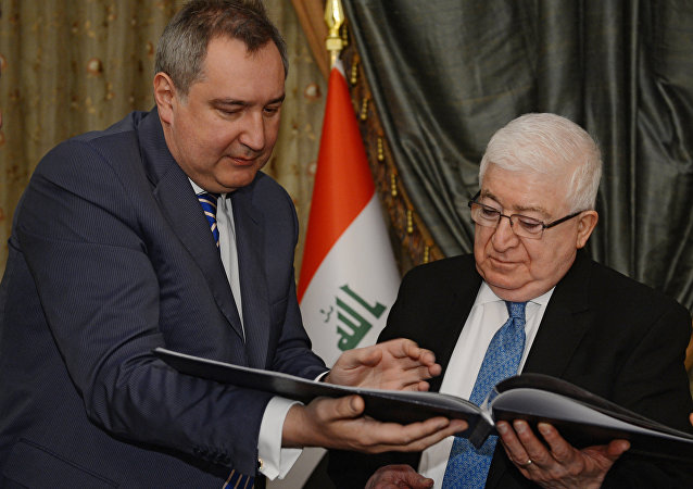 Russian Deputy Prime Minister Dmitry Rogozin, left, and President of Iraq Fuad Masum meet in Baghdad. Day Two