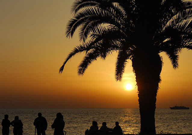 Walking along the embankment in Sochi duirng the sunset.