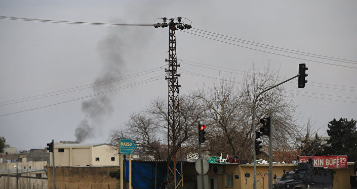 Smoke billows from a fire at the southeastern town of Nusaybin, Turkey, near the border with Syria, where Turkish security forces are battling militants linked to the Kurdistan Workers Party or PKK, Sunday, Feb. 14, 2016.