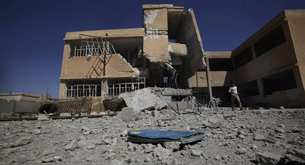 A book is left on the ground at the yard of a school in Tel Rifaat, on the outskirts of Aleppo, Syria (file photo)
