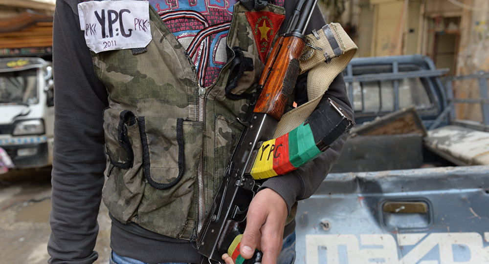 A Kurdish fighter from the Popular Protection Units (YPG) is pictured in the majority-Kurdish Sheikh Maqsud district of the northern Syrian city of Aleppo, on April 21, 2013.