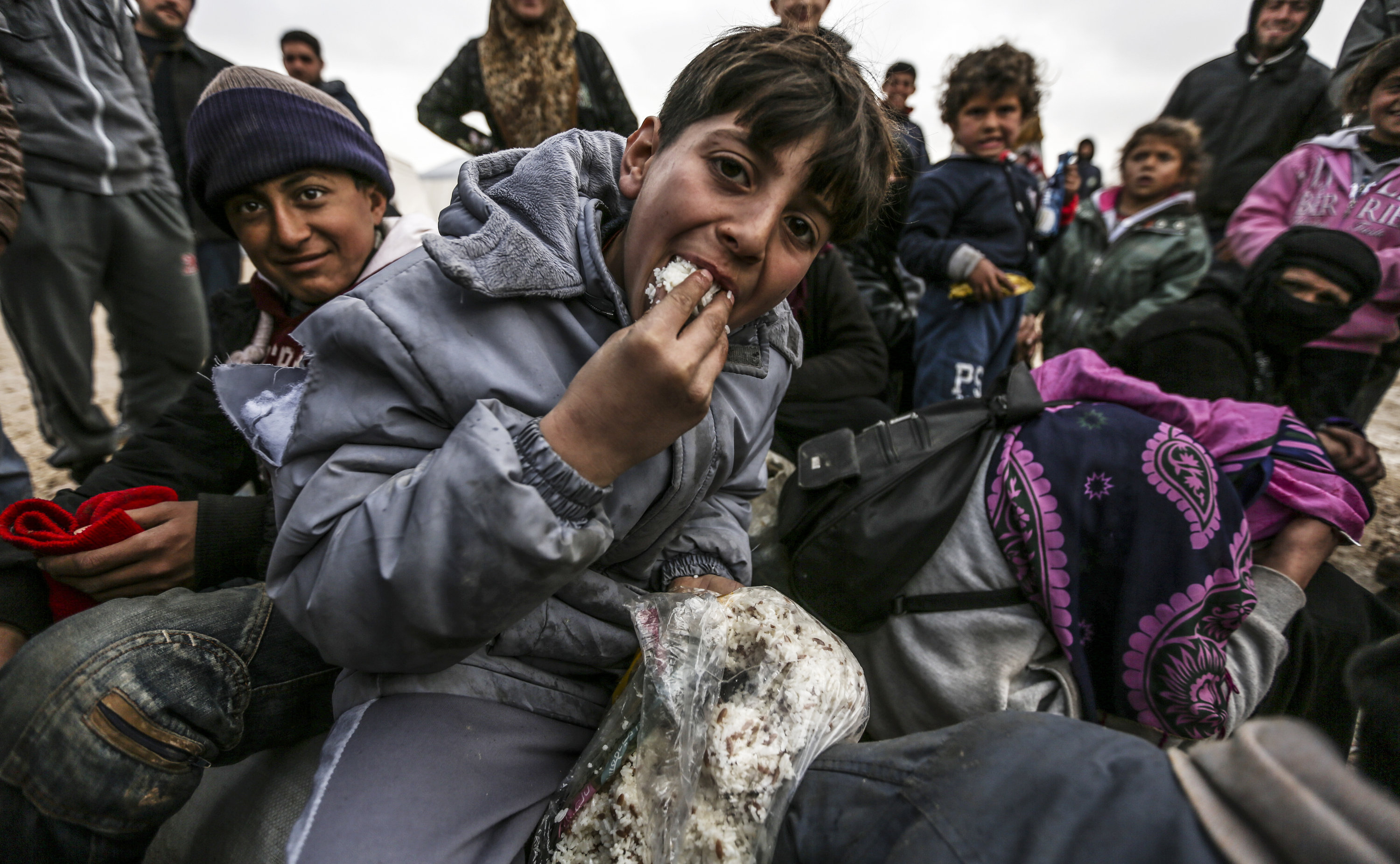 Syrian refugees are pictured in a camp as Syrians fleeing the northern embattled city of Aleppo wait on February 6, 2016 in Bab al-Salama, near the city of Azaz, northern Syria, near the Turkish border crossing.