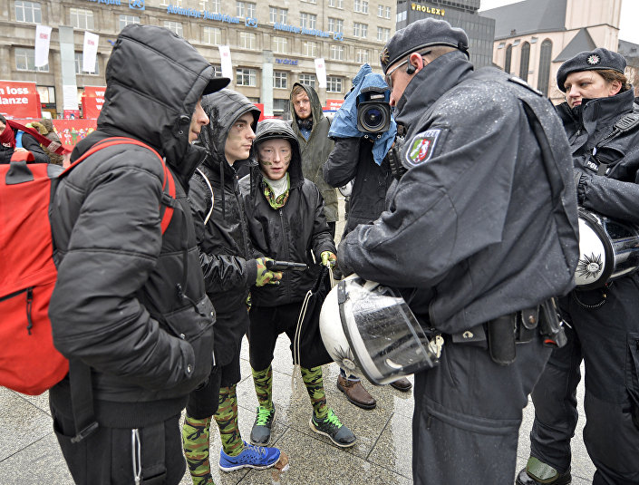 Police check toy guns during the start of the street carnival in Cologne, Germany.