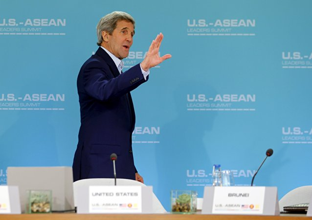 US Secretary of State John Kerry waves as he arrives in a meeting room for the start of a 10-nation Association of Southeast Asian Nations (ASEAN) summit in Rancho Mirage, California February 15, 2016.