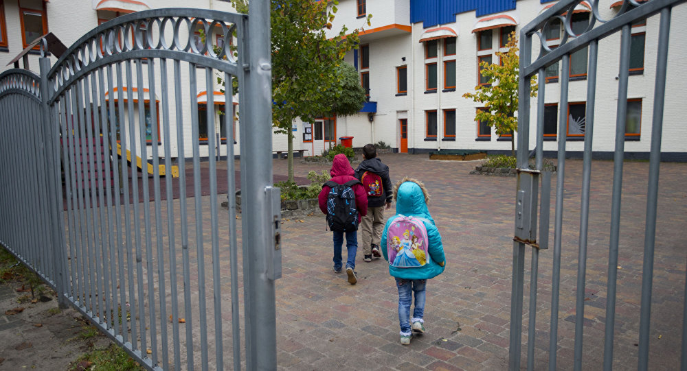 Migrant's children walk towards their school in the village of Oranje, Netherlands, Thursday, Oct. 8, 2015