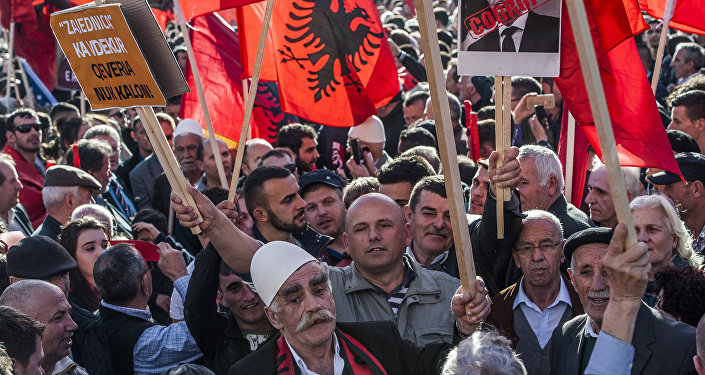 Kosovo Albanians, some holding Alkbania's flag, gather in Pristina on February 17,2016 for a major anti-government rally to mark their eighth anniversary of independence from Serbia.