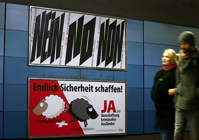 A poster of Swiss People's Party (SVP), demanding to vote for an initiative to deport criminal foreigners, is placed underneath another one against it at the central railway station in Zurich, Switzerland February 12, 2016
