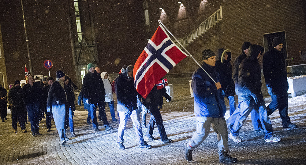 Supporters of the Norwegian wing of Germany's anti-Islamic Pegida movement hold national flags of Norway as they demonstrate on January 19, 2015 in Oslo