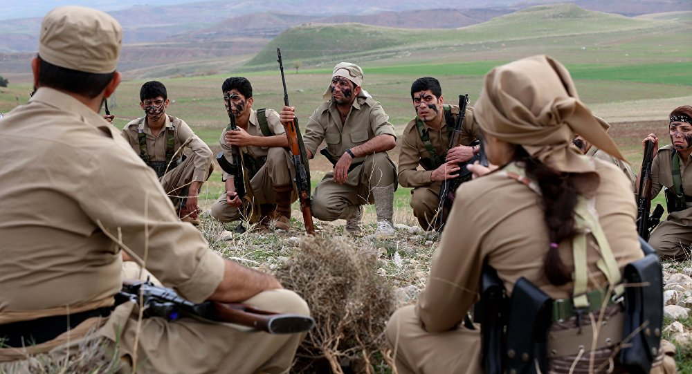 Iranian Kurdish Peshmerga members of the Kurdistan Democratic Party of (KDP-Iran) take part in routine military exercises in Koya, 100 kms north of Arbil, the capital of the autonomous Kurdish region of northern Iraq, on December 9, 2014