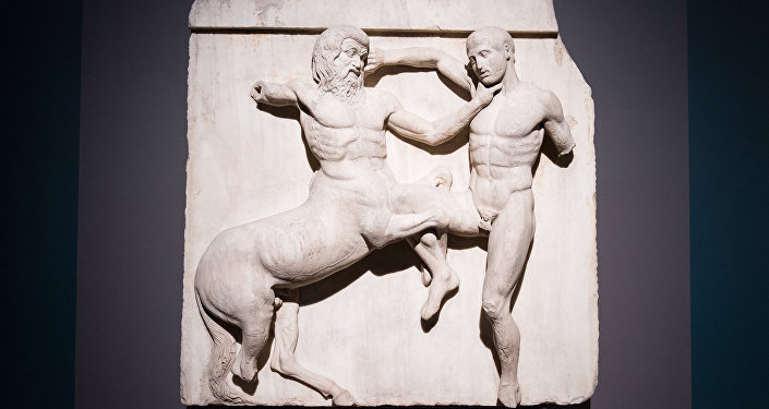 A marble metope sculpture (447-438BC) from the Parthenon in Athens, part of the collection that is popularly referred to as the Elgin Marbles, depicting a battle between a Centaur and a Lapith.