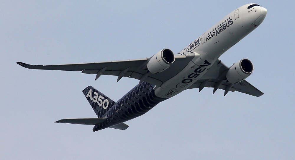 An Airbus A350 flies past during a preview aerial display of the Singapore Airshow at Changi exhibition center in Singapore February 14, 2016